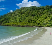 Stroll along the Cape Tribulation Beach beach and boardwalk to the photographers' platform overlooking the mountains and coast where the 'Rainforest meets the Reef'