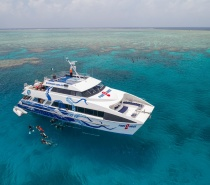 join us for a once in a lifetime adventure aboard our luxury day trip to the great barrier reef.