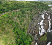 Journey to the picturesque mountain village of Kuranda via the historic Kuranda Scenic Railway.